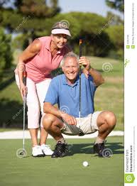 senior golf couple
