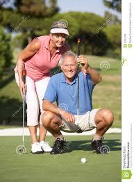 senior golf couple